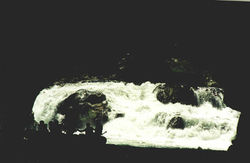rafters_in_tunnel,_rapids_behind.jpg